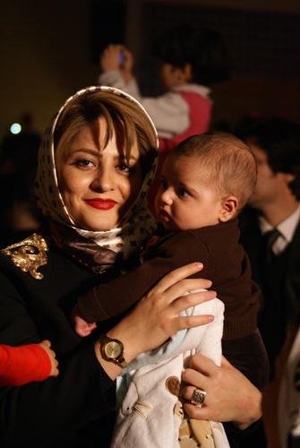Hoda Soleymani Vadipoor with her son Barbod. By Mateusz Jaworski