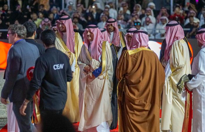 In the middle: Prince Saud Bin Naif Bin Abdulaziz Al Saud, by Monika Luft